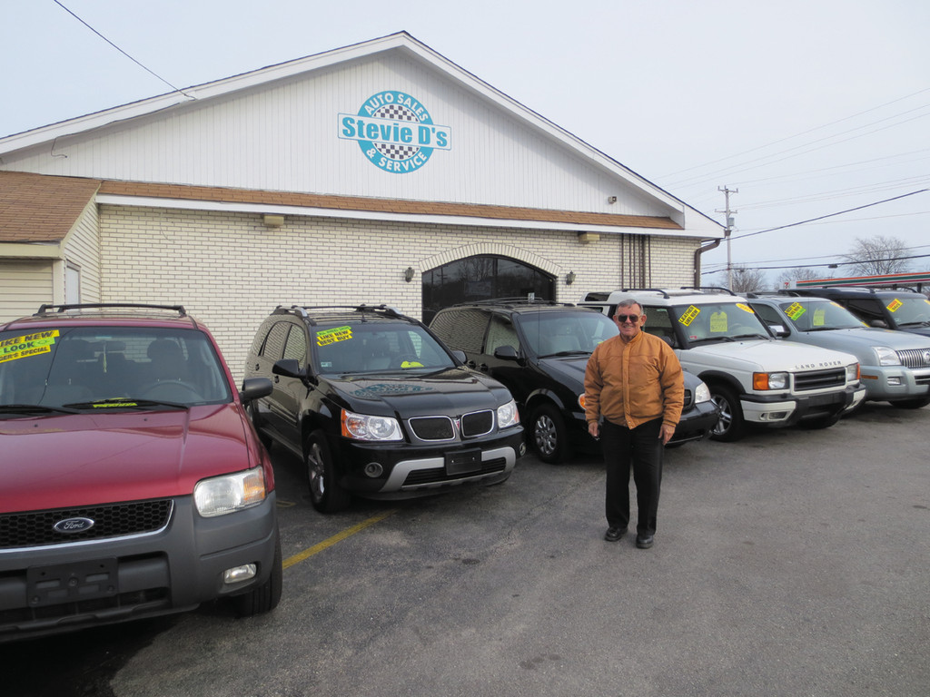 Prospective buyer John Fernandes checks out the huge inventory of vehicles at Stevie D's on Oakland Beach Avenue - come in today and find a great deal of your own!