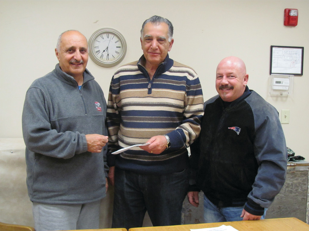 "Vin LaFazia (left) presents a check for $1,500 to Dennis Quaranta, chairman of the Campfires for Cancer Committee, on behalf of the annual Richard ""Ricky"" Salzillo Memorial Game Dinner. Proceeds from that affair benefit different local charities. Looking on is John Graham, a member of both committees."