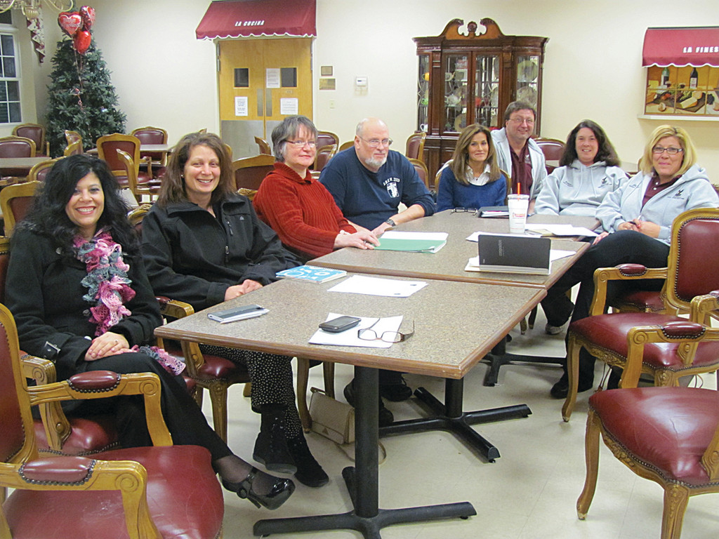 Among those parents of Johnston Police Explorers Post No. 405 members who are planning the April 21 Macaroni and Meatball Dinner, are, from left, Gina Sabitoni-Arakelian, Debbie Monteiro, Deborah Rocha, Ray Rocha, Lucia Fernandes, Paul Santurri, Joan Tenerella, John Bousquet and Jan Riley.