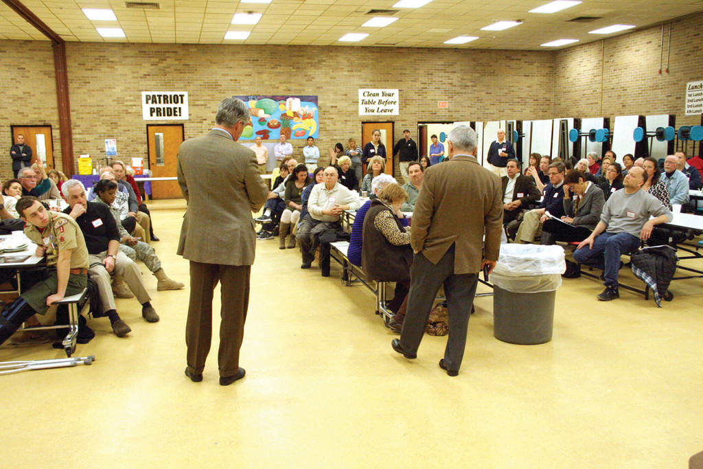ANSWERS: Senators Sheldon Whitehouse and Jack Reed field questions at the community dinner meeting Whitehouse hosted Sunday at Pilgrim High.