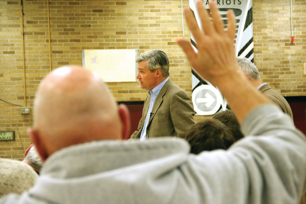 NO SHORTAGE OF QUESTIONS: Senator Sheldon Whitehouse answers questions at Sunday's dinner at Pilgrim, as a member of the audience seeks to be recognized.