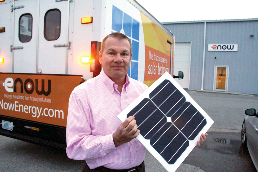 ON THE ROAD TO SAVINGS: Jeffery Flath, president and CEO of eNow, outside the truck he's driving around the country to demonstrate how truckers can save an estimated $10,000 in fuel costs with the addition of a solar powered system.