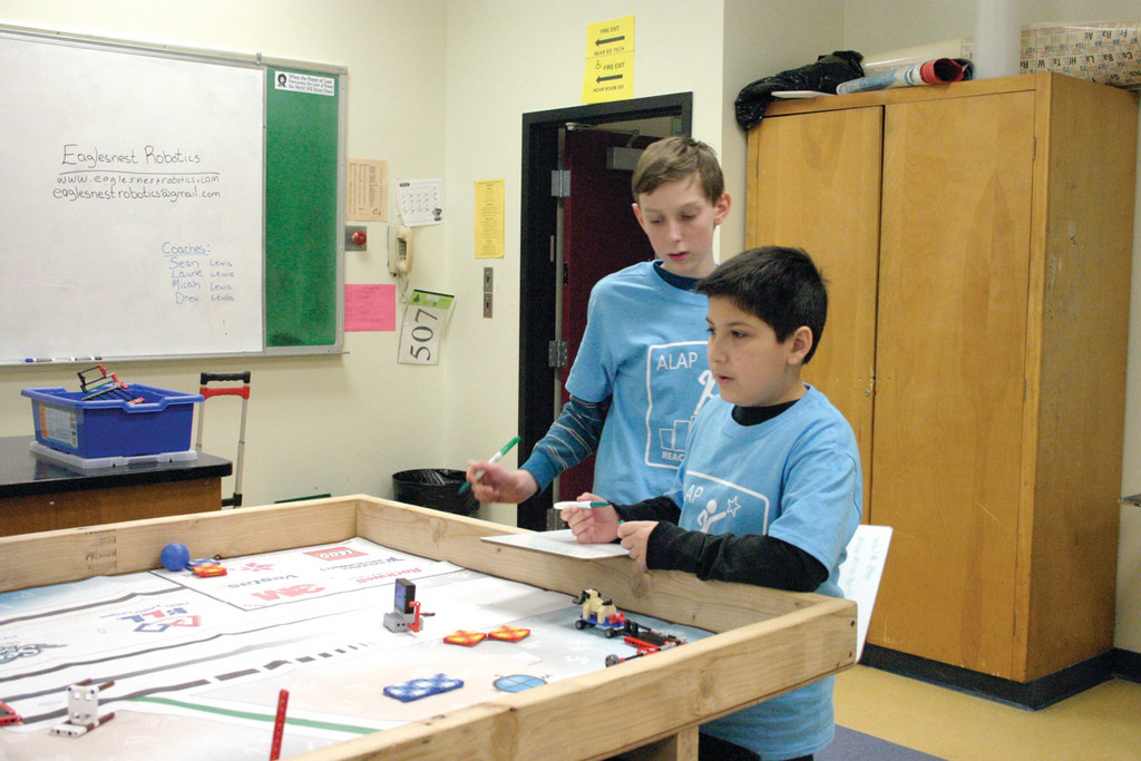 FUTURE ENGINEERS: Alex Gavitt and Steven Defreitas use technology and robotics to complete a task in �LEGO Robotics.�