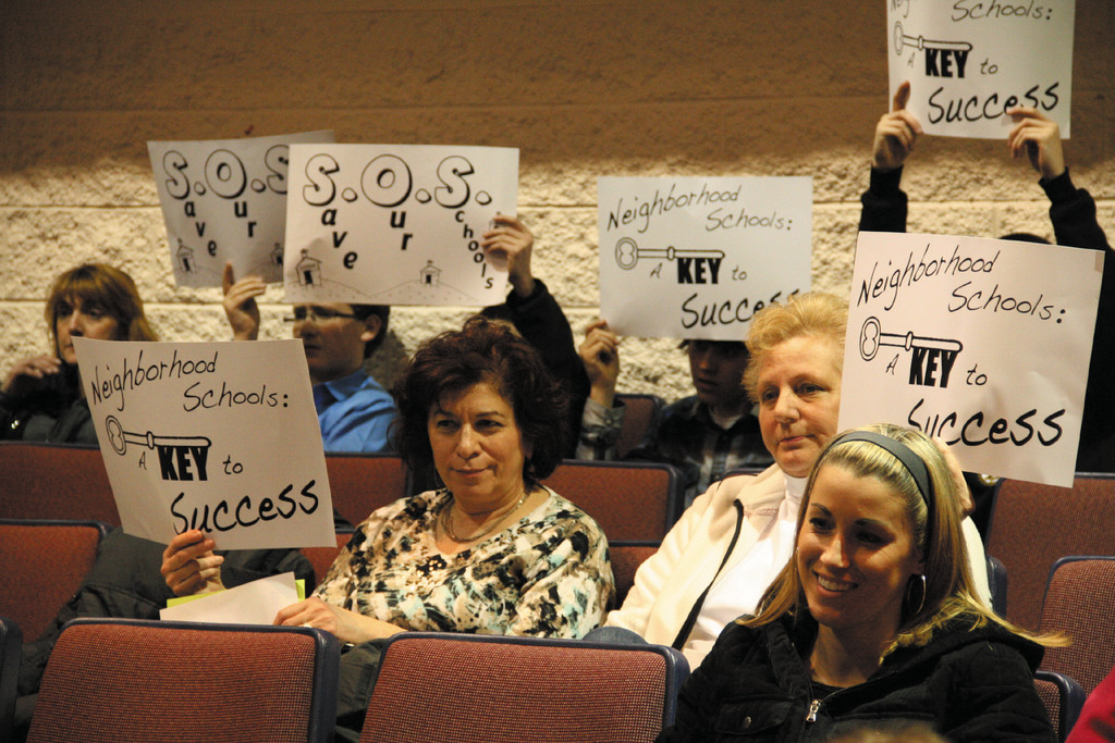 MAKING THEIR POINT: Those opposed to closing Gorton gathered in the rear of the auditorium to express their point.