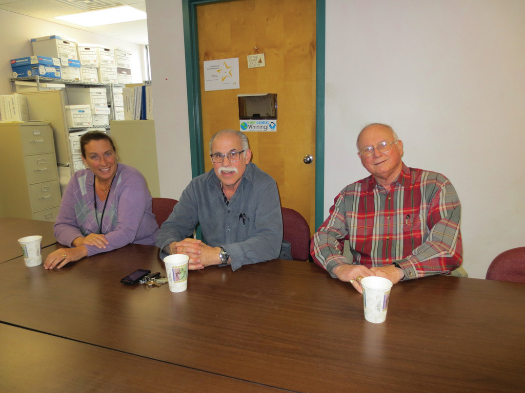 VOLUNTEERS THEY DEPEND ON: Dedicated volunteers Kathy Quattrini, Bill DiPippo and Donald Stubbs gather for one of their monthly volunteer support meetings.