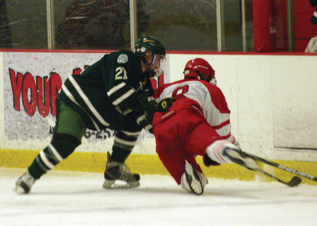 Ed Markowski makes a play on the boards. Fera and Markowski lead the way on the Hawks' top line.