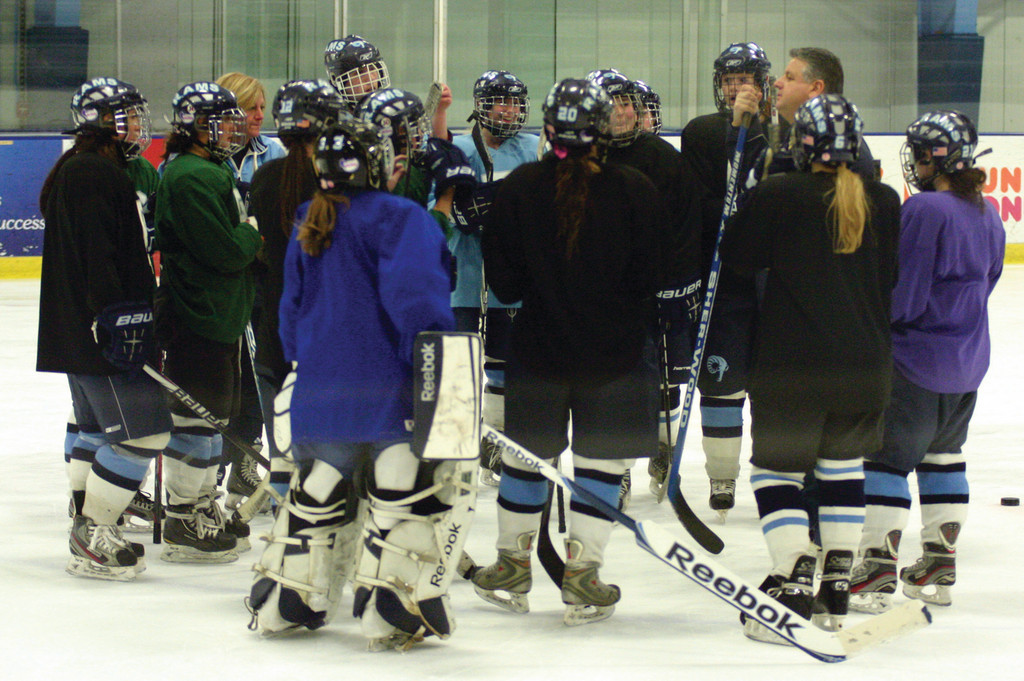 READY TO GO: The URI women's hockey team gathers together during practice.