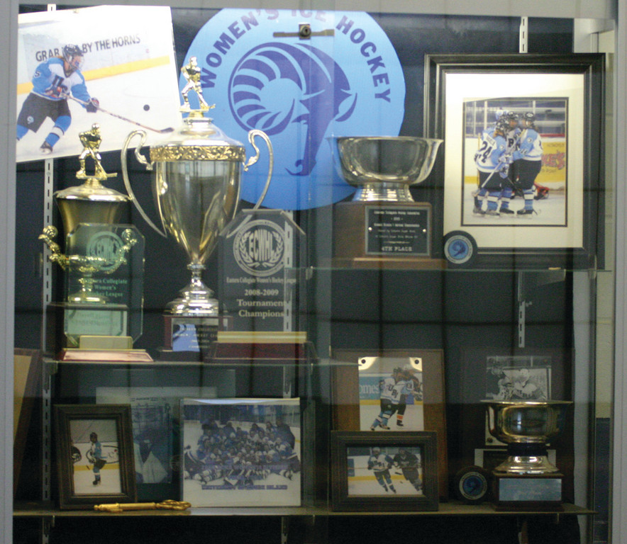 The URI trophy case shows all the hardware the women's hockey program has won in its previous trips to the national tournament.