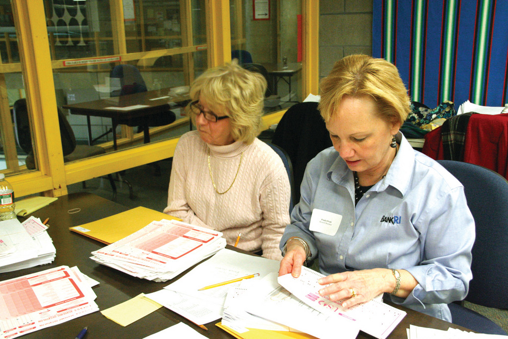 LOTS OF TESTS: Volunteers Christine Young and Paula Prattcheck test returns in the scoring room.