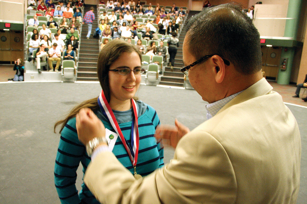 A WINNER: Toll Gate�s Julie Burns is presented a medal by Mayor Allan Fung during the awards ceremony.