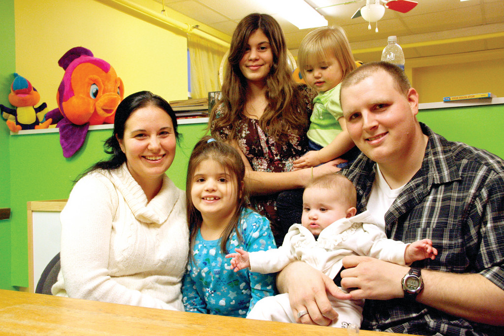 ALL IN THE FAMILY: Mandi Golato and Mark Griffin, who will be wed March 23 at the RI Family Shelter, pose with their family of daughters. The eldest, Victoria, holds Tina. Seated in front is Aaliyah, and Mark holds Destiny.