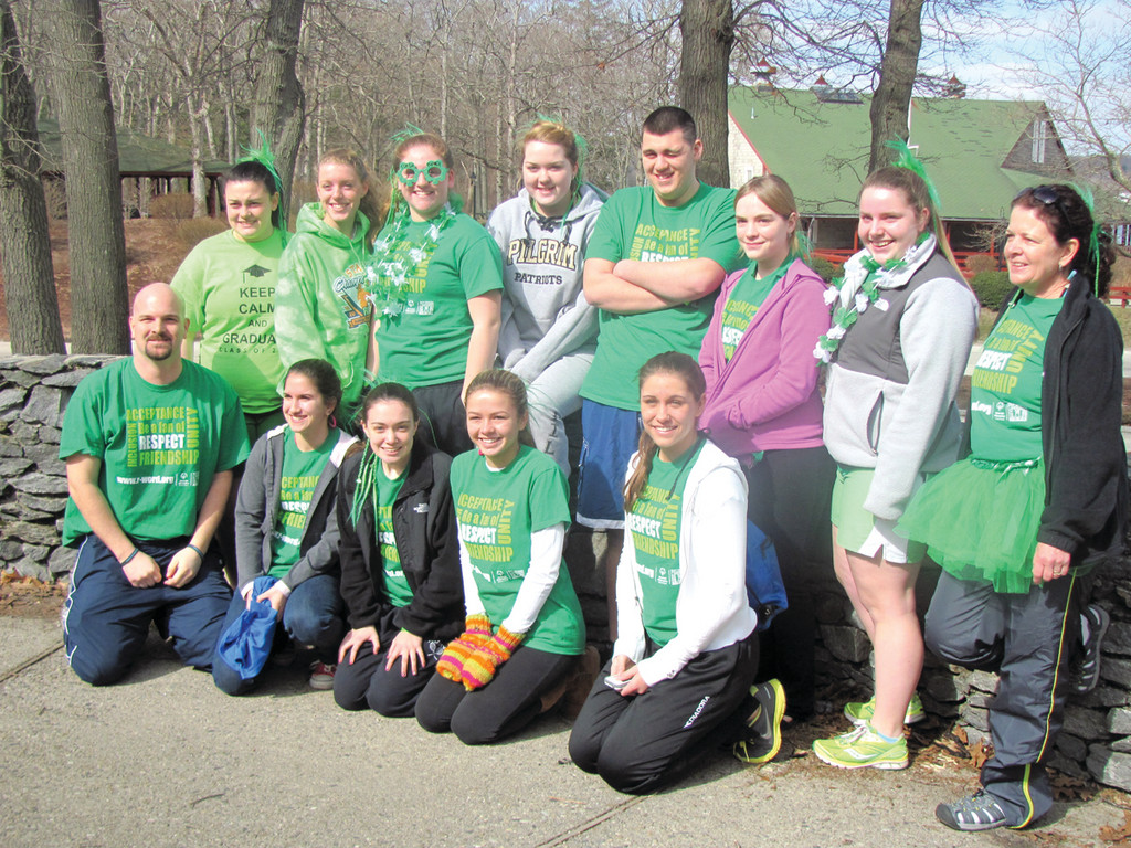 PATRIOTS POWER: This is the Ian Smith-led Pilgrim High School group of students who Sunday participated in the sixth annual Torch Run Plunge at Goddard Memorial State Park. More then 125 people of all ages took the plunge in 40-degree water and raised a record $50,000 for Special Olympics Rhode Island.
