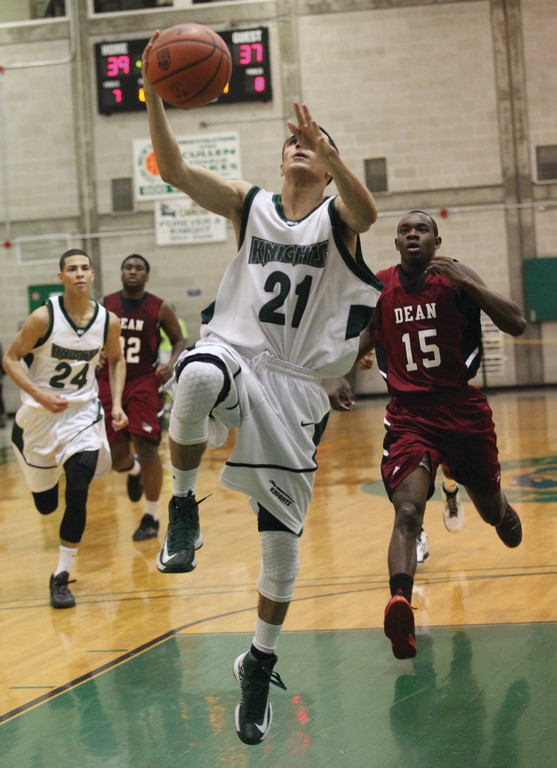 SOARING: CCRI point guard Bryan Yarce goes up for a fast break layup earlier this year