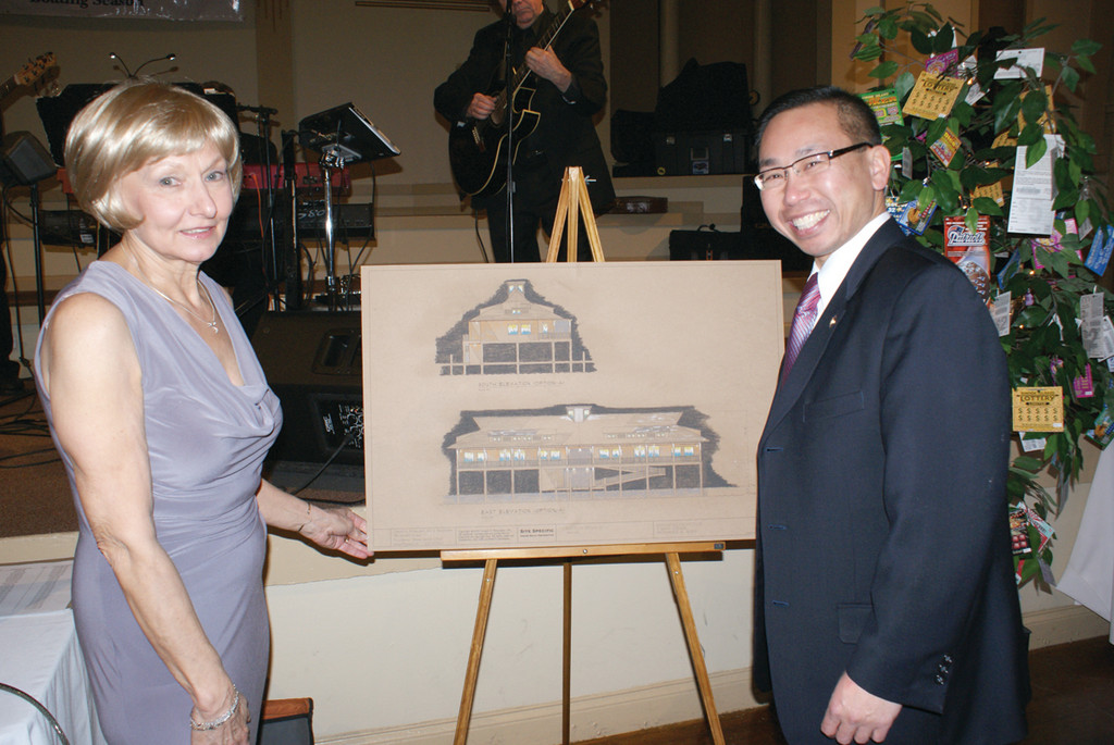 CHARTING THE COURSE: Edgewood Yacht Club Commodore Marie DeRoche and Cranston Mayor Allan Fung check out the architects' rendering of the new clubhouse.