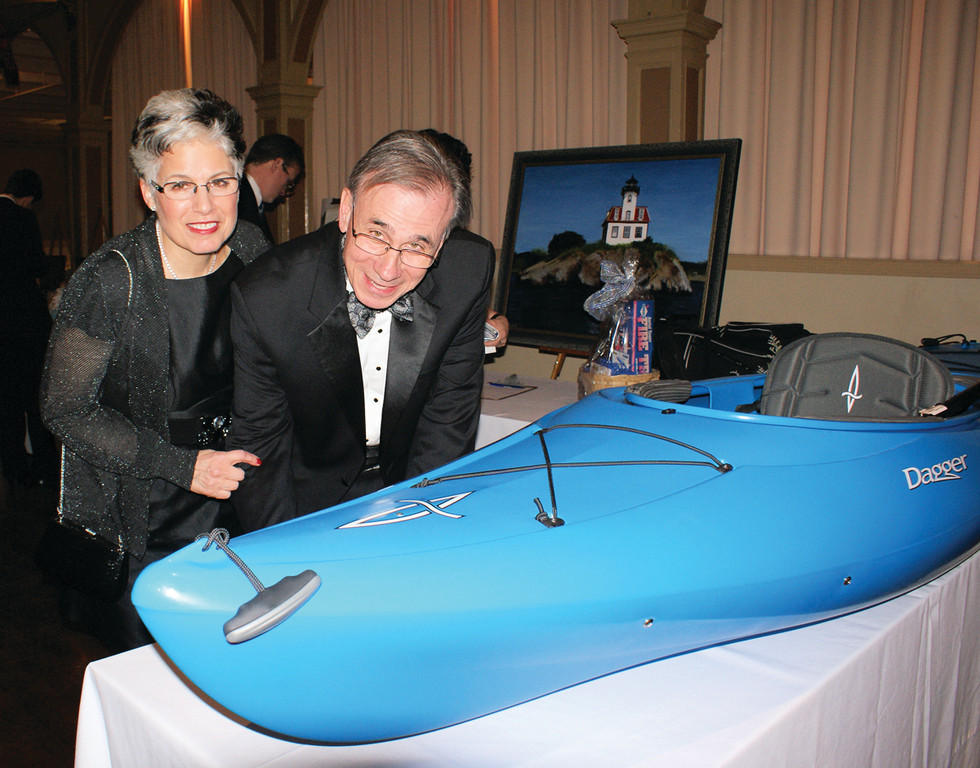 "KAYAK BID: During the Edgewood Yacht Club's ""Charting Our Course"" Gala, there were 19 silent auction items up for bid, including a kayak which was being bid on by Vice Commodore of the Edgewood Yacht Club Wayne Kezirian and his wife Elizabeth."