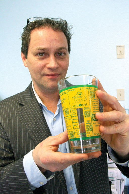 TRIVIA COULD PAY OFF: Richard Nuttall with one of the glasses he's supplying at no cost to local restaurants and bars.