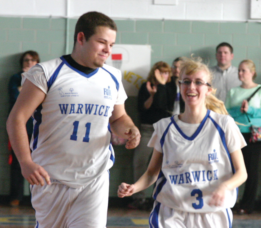HAPPY DAYS: Cory Kershner and Courtney Brunelle are all smiles after a basket during Wednesday's unified basketball game between Vets and Toll Gate.