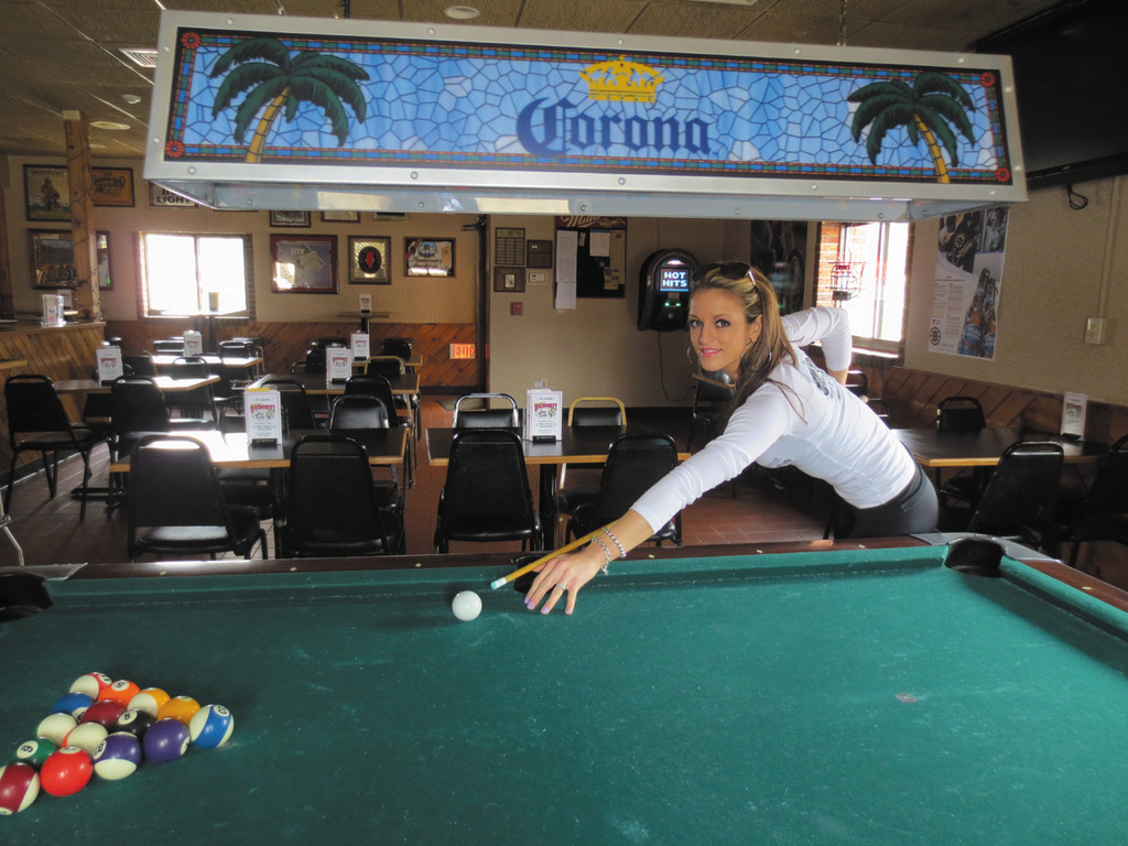 Bartender Kathleen Gonsalves mixes up the crowd at Moranto's Backstreet with a game of pool ~ come sample a corned beef sandwich on March 17, starting at 3 p.m.