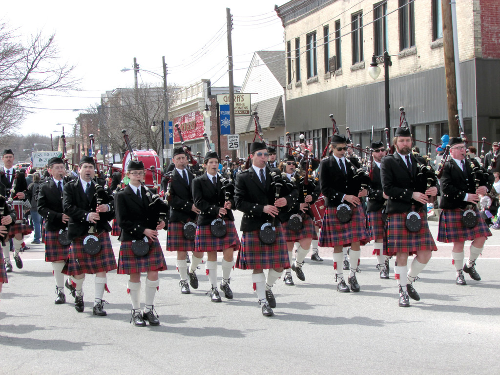 MUSIC TO MARCH BY: The Rhode Island Highlanders Pipe Band march in Sunday's St. Patrick's Day parade in West Warwick before performing at the post-party at the Elks Lodge later that day.