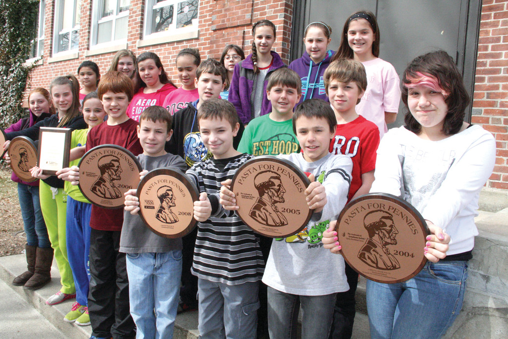 That�s the amount Greenwood School students aim to raise by the end of the week in their Pasta for Pennies campaign to benefit the Leukemia and Lymphoma Society. The school is especially motivated to reach the goal as a tribute to Denise Walker, the teacher who organized the drive in prior years and died of cancer last month. Here, the student council comprised of 5th and 6th graders gather outside the school with awards from prior drives. As of Monday $958 had been raised. Olive Garden treats the class that raises the most to a pasta lunch. School Principal Dennis Winn writes about Mrs. Walker in today�s letters to the editor.