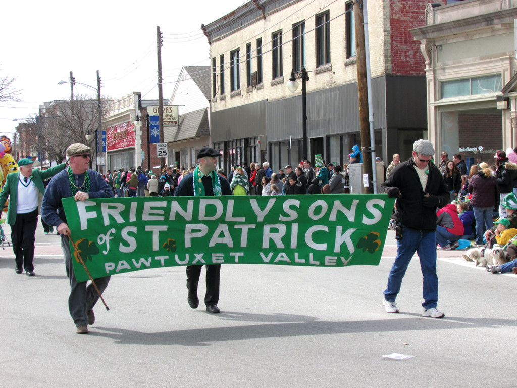 RI'S IRISH HISTORY: Jack Daily, Mike Kelly and Tim Daily lead the Friendly Sons of St. Patrick group during the parade's first division. The state's oldest Irish organization has sponsored the parade since 1959.