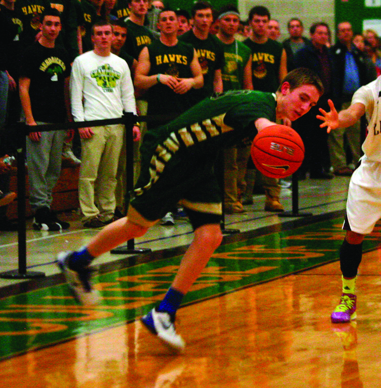 IN THE HUNT: Hendricken's Kyle Henseler tries to grab possession of the ball against La Salle during first-round state tournament action last month.