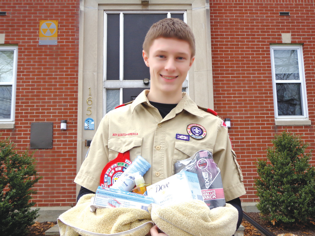 CLEANING UP: Nakia Medeiros holds bathroom items he�s collecting for his Eagle project in order to assemble health care kits and distribute to families at the Rhode Island Family Shelter in an effort to help them stay clean and free of illness.