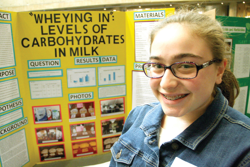 MEASURING MILK CARBOHYDRATES: Johnston High School student Joely Centracchio�s project in biochemistry focused on carbohydrates in different varieties of milk. She concluded soymilk had the least carbohydrates.