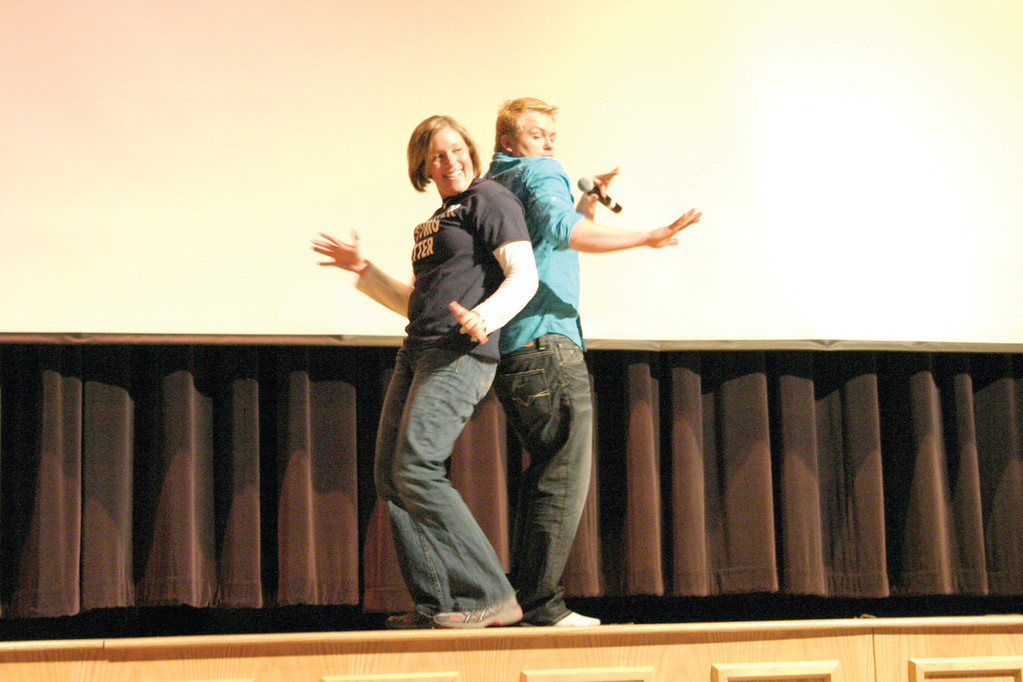 DANCE BREAK: During one of the presentation's lighter moments, Craig Scott pulls English teacher Melissa Heywood on stage for a dance.