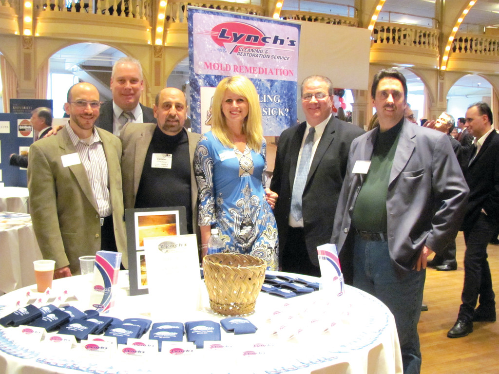 MAKING CONNECTIONS: This is an example of how more than 1,000 people enjoyed networking at Rhodes-on-the-Pawtuxet during Tuesday's Statewide Business After Hours. The group includes: Anthony Ursillo, NCCC board member; Steve MacGillivray, Telecom Consultants of Barrington; Shawn Lynch of Lynch's Cleaning & Restoration; Michelle Lee of Michelle Lee Designs, also of Cranston and its Chamber; Cranston Chamber President Steve Boyle; and Lynch's Marketing Manager Carmine DeLuca.