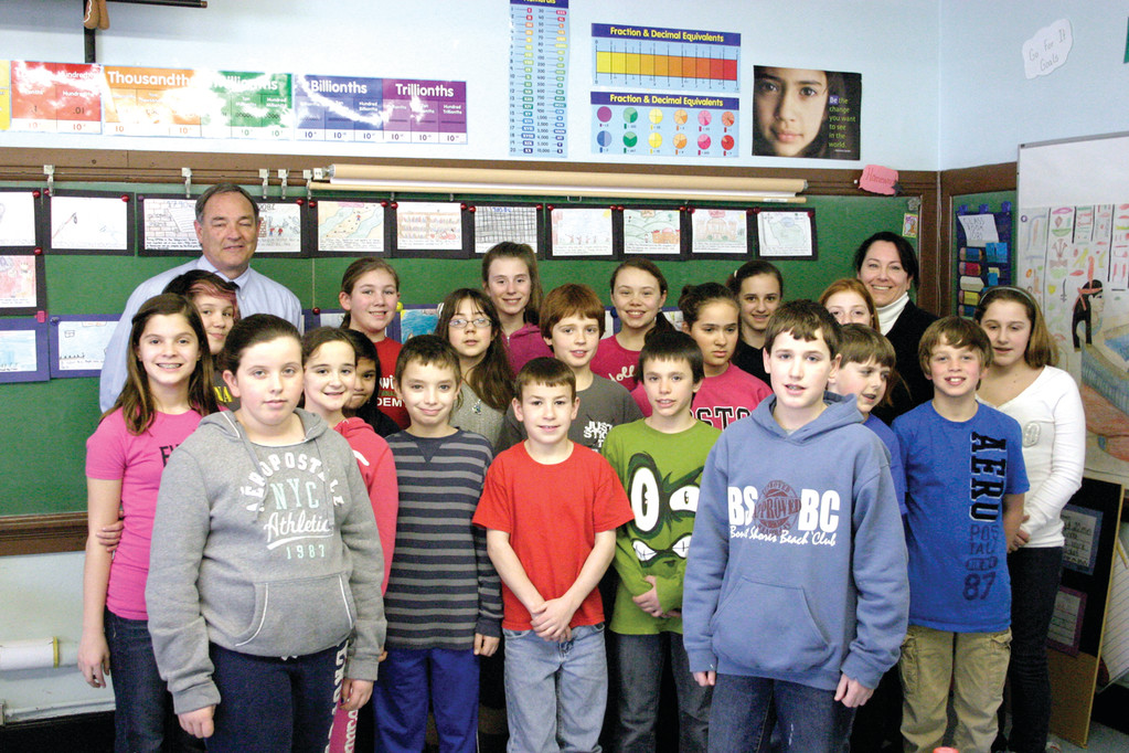 GREENWOOD TEAM: Greenwood Elementary School�s student council with school principal Dennis Winn (top far left) and teacher Cheryl Stacy (top far right).