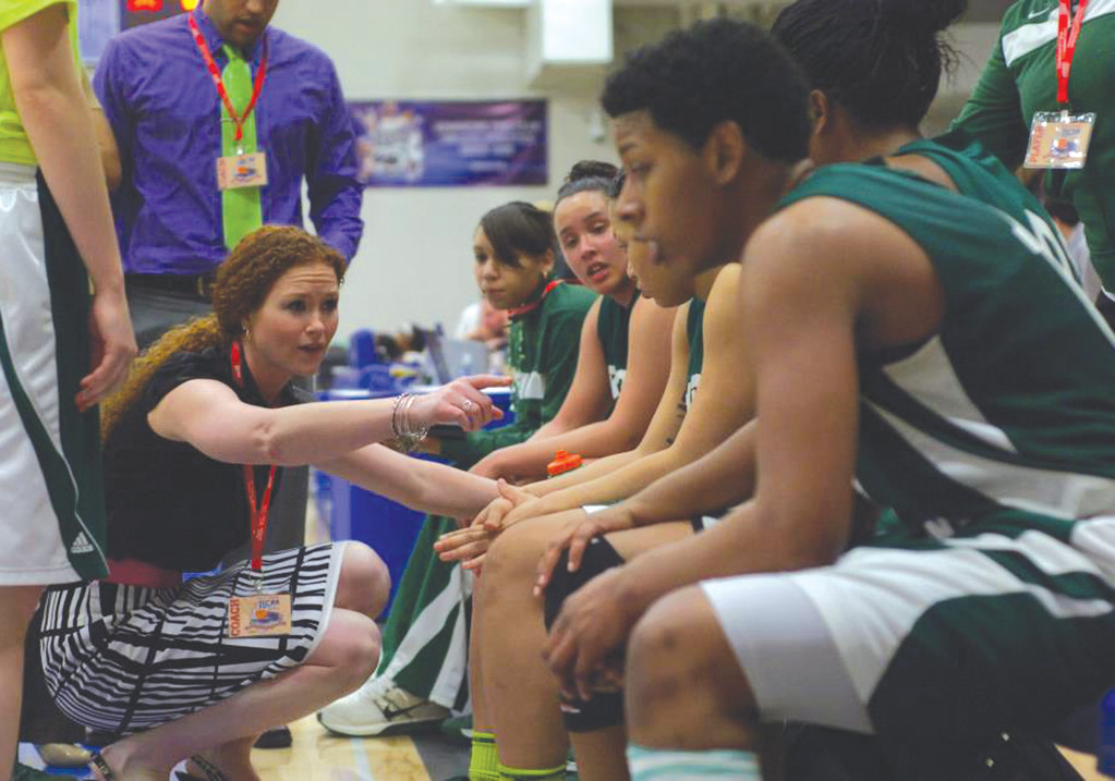 MOTIVATION: CCRI head coach Kate Lynch talks to her team during the Lady Knights' victory over Owens at the NJCAA D-II national tournament on Tuesday.