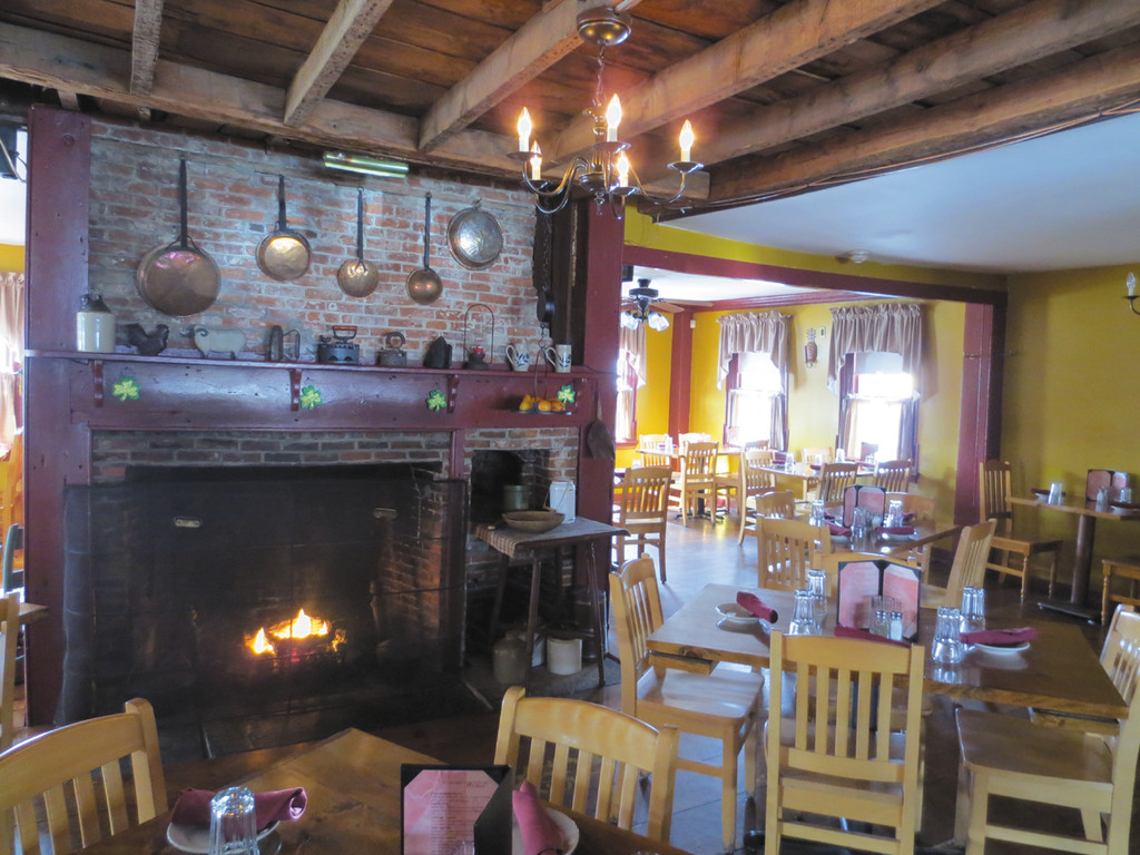The cozy fireplace and dining room of The Remington House Inn awaits you.
