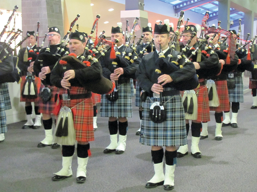SENDOFF: Members of the Providence Police Pipes and Drums join fellow musicians from the Rhode Island Professional Firefighters Pipes and Drums during last Saturday�s ceremony at TF Green Airport.