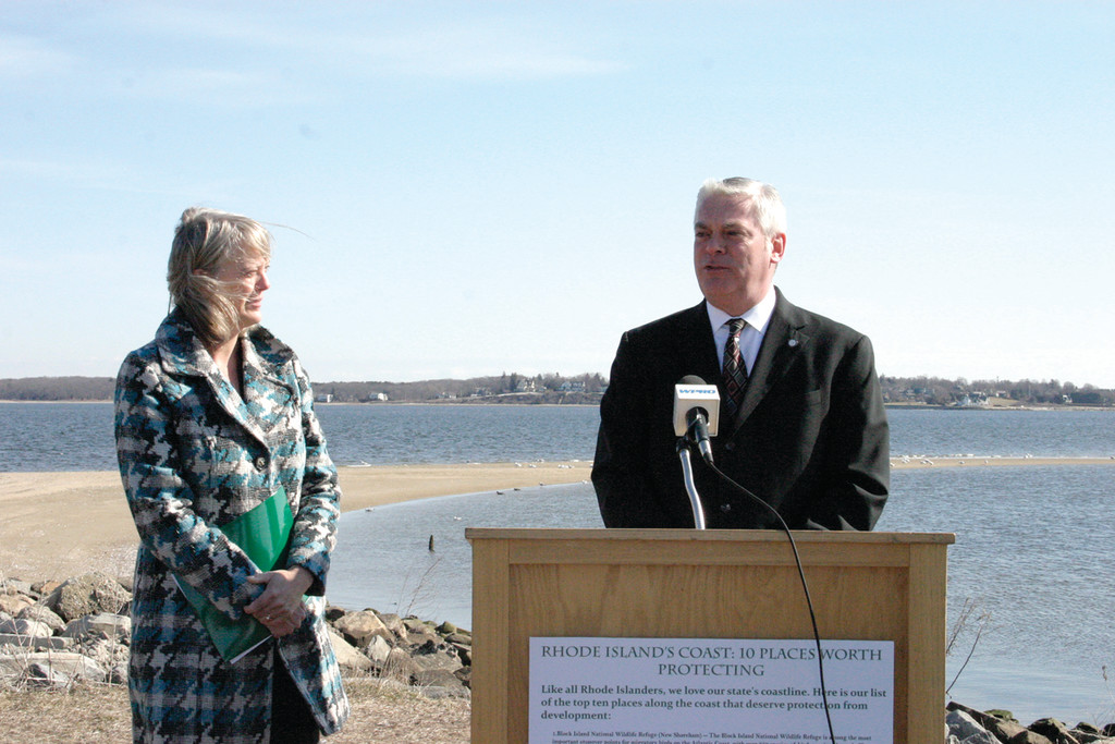 ENJOYING NATURE: Despite the wind, Mayor Avedisian and Director Janet Coit came out to support Environment Rhode Island�s efforts to preserve the state�s coastline.