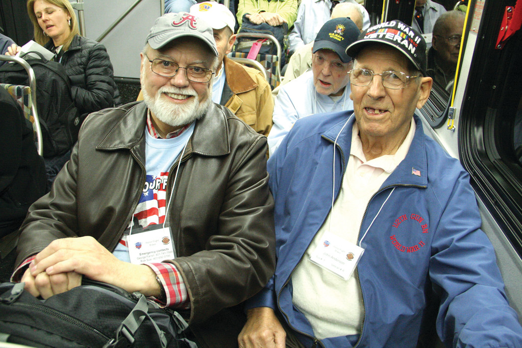 VET AND HIS GUARDIAN: Among those World War II veterans who made the Honor Flight Bravo trip to Washington, D.C. last Saturday was John Anderson. He is accompanied by Wayne Moore, both of East Greenwich.