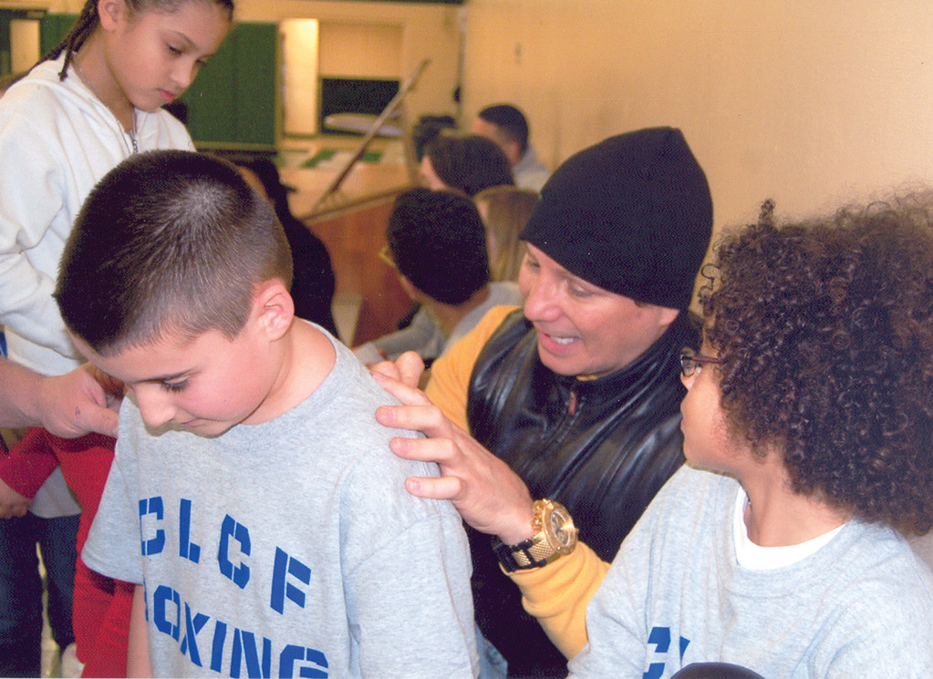 BACK HOME: Vinny Paz poses with a group of CLCF boxers. Paz was a member of CLCF boxing back in the 1960�s.
