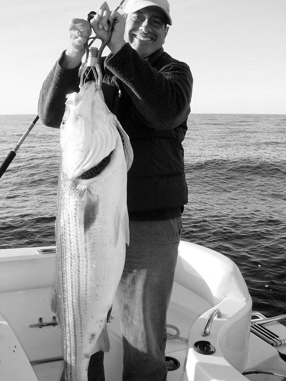Get your gear ready: Make sure your gear is ready for the fishing season as you never know when a big fish will hit, like this 40 pound striped bass that Capt. Dave Monti is holding.