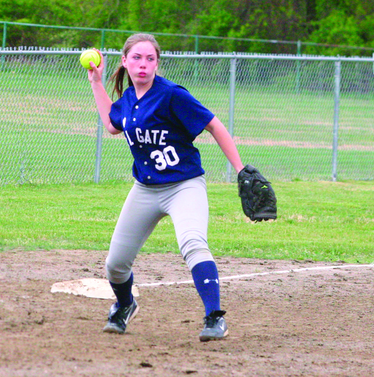 HOT CORNER: Courtney Conklin makes a throw across the diamond during a game last year.