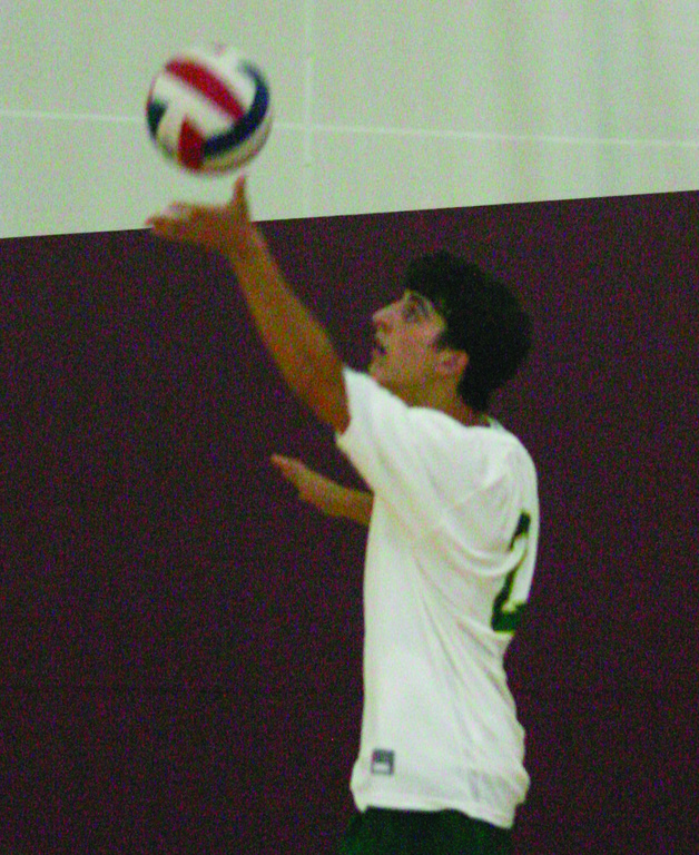 RETURNING: Derek Vadnais gets set for a serve during the playoffs last year.