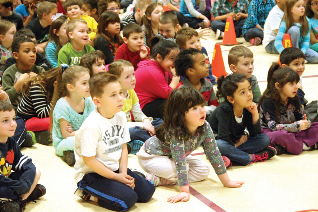 SOAKING IN THE MESSAGE: John Wickes School students listen to the book �Is Your Hair Made of Donuts?�