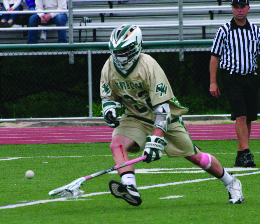 SCOOP: Above, Hendricken's Alex Perreault chases down a ground ball during a game last season.
