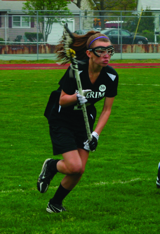 ON THE RUN: Pilgrim's Britney Howland charges up the field from her spot on defense in a game last year.
