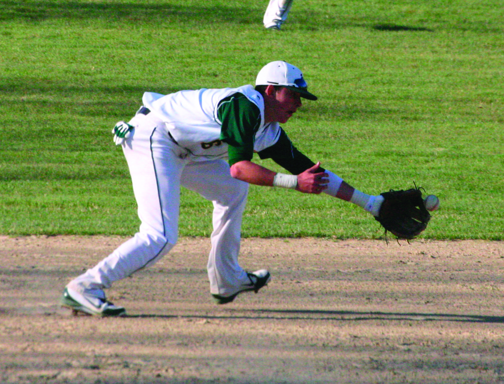 MATT MURPHY reaches for a ground ball.