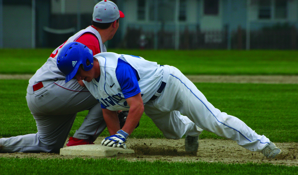 SAFE: T.J. Boyajian dives back into first base against East Providence last season. Boyajian is a returning All-State player for the 'Canes.
