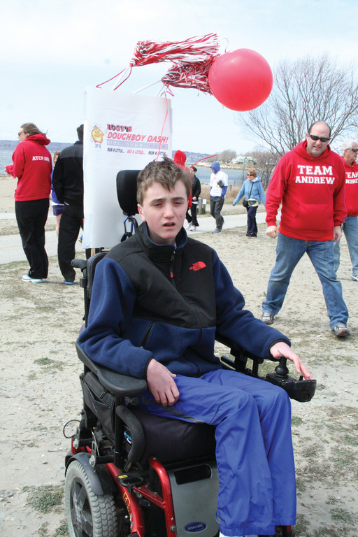 LEADER OF THE PACK: 13-year-old Andrew Martin, who was diagnosed with A-T at the age of four, led the group for the start of the first one-mile circuit and stayed outside to watch the runners despite the cold and windy conditions.