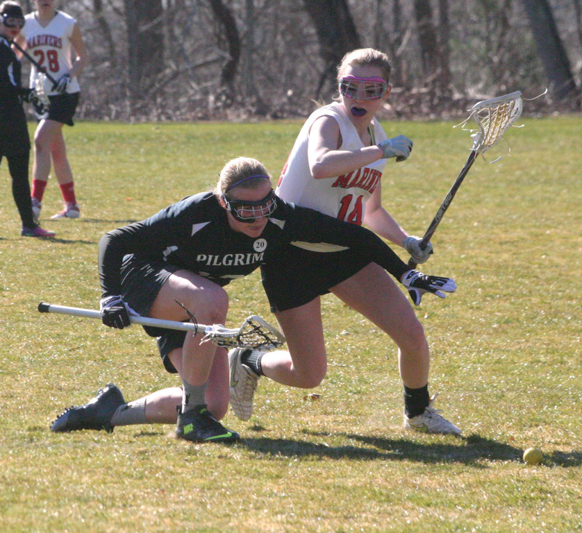 Betsy Heidel battles for a ground ball.