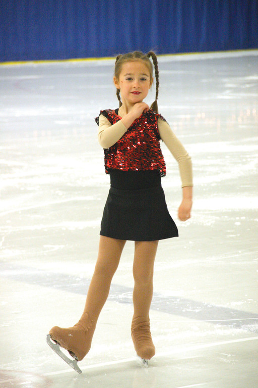 QUIET MOMENT: Annette Blackwell pauses during the routine featuring her age group of skaters.