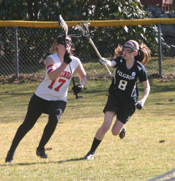 ONE ON ONE: Pilgrim's Britney Howland stays close to Narragansett's Eliza DeCubellis in Saturday's game.