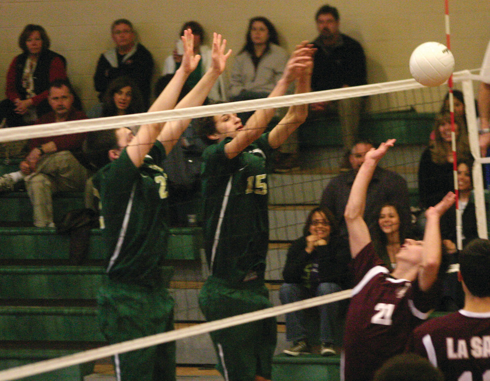 SKYING: Mason Cote and Donny Baker rise up for a block.